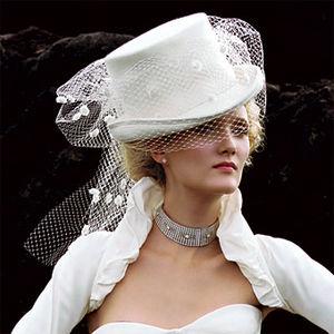Matrimonio invernale: scelta outfit per abito e cappello